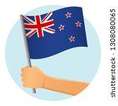 new zealand flag in hand.... | Shutterstock .eps vector #1308080065