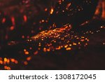 Small photo of Coals burn and smolder in the furnace