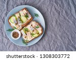 Stock photo herring smorrebrod traditional danish sandwiches black rye bread with herring on dark gray 1308303772