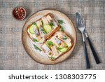 Stock photo herring smorrebrod traditional danish sandwiches black rye bread with herring on gray napkin 1308303775
