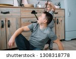 young man and his son with oven ... | Shutterstock . vector #1308318778