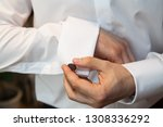 a man puts on an expensive... | Shutterstock . vector #1308336292