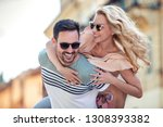 smiling couple in love outdoors.... | Shutterstock . vector #1308393382