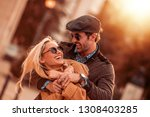 happy young couple having fun... | Shutterstock . vector #1308403285