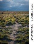 A Hiking Trail Leads Across A...
