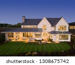 luxury home exterior at night ... | Shutterstock . vector #1308675742