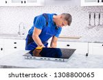 side view of a mature repairman ... | Shutterstock . vector #1308800065