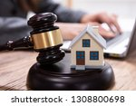 house model with gavel in front ... | Shutterstock . vector #1308800698