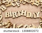 birthday word made with wooden... | Shutterstock . vector #1308802072