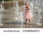 little girl plays with water in ... | Shutterstock . vector #1308886855