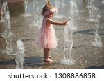 little girl plays with water in ... | Shutterstock . vector #1308886858
