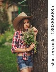 beautiful young cowgirl with... | Shutterstock . vector #1308886885