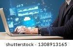 businessman hand typing on... | Shutterstock . vector #1308913165