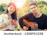 asian younger man and woman... | Shutterstock . vector #1308951538