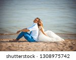 wedding couple on the beach | Shutterstock . vector #1308975742
