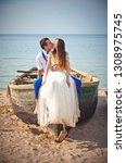 wedding couple in a boat on the ... | Shutterstock . vector #1308975745