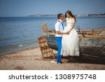 wedding couple in a boat on the ... | Shutterstock . vector #1308975748