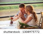 young couple in an open air cafe | Shutterstock . vector #1308975772