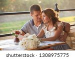 young couple in an open air cafe | Shutterstock . vector #1308975775