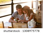 young couple in an open air cafe | Shutterstock . vector #1308975778