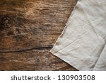 Tablecloth On Wooden Table...