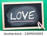 love word on blackboard and...   Shutterstock . vector #1309043005