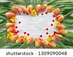 tulips frame with hearts on... | Shutterstock . vector #1309090048