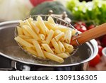 cooking pasta in a pot with... | Shutterstock . vector #1309136305