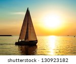 yacht sailing against sunset.... | Shutterstock . vector #130923182