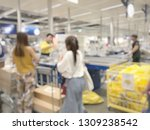 blurred image of cashier with... | Shutterstock . vector #1309238542