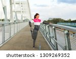 active woman stretching legs on ... | Shutterstock . vector #1309269352