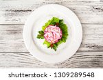 Stock photo herring salad under a fur coat with crabs on a white plate traditional russian cuisine herring 1309289548