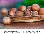 close up of hazelnuts on wooden ... | Shutterstock . vector #1309349755