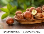 close up of hazelnuts on wooden ... | Shutterstock . vector #1309349782