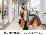 stylish fashion young woman... | Shutterstock . vector #1309374412