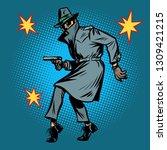 detective spy man with gun pose.... | Shutterstock .eps vector #1309421215