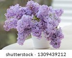 lilacs of bouquet in a white... | Shutterstock . vector #1309439212