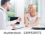 male doctor is talking to...   Shutterstock . vector #1309520572