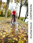 cyclist ride through a puddle... | Shutterstock . vector #130956446