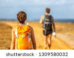hiking people couple walking... | Shutterstock . vector #1309580032