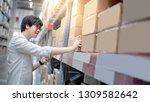 young asian shopper man picking ... | Shutterstock . vector #1309582642