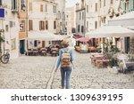 tourist girl walking in the... | Shutterstock . vector #1309639195
