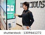indian man customer at store... | Shutterstock . vector #1309661272