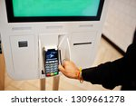 hands of man customer at store... | Shutterstock . vector #1309661278