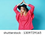 woman in a black hat holds her... | Shutterstock . vector #1309729165