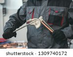 Pipe Bender Tool In A Hands Of...
