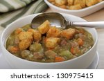 closeup of a bowl of split pea... | Shutterstock . vector #130975415