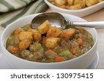 closeup of a bowl of split pea... | Shutterstock . vector #130975415