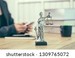 attorney woman texting on... | Shutterstock . vector #1309765072