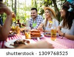group of happy friends eating... | Shutterstock . vector #1309768525